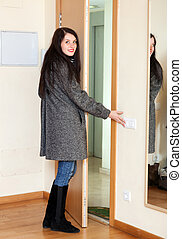 Smiling woman   leaving  home