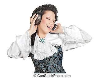 Smiling woman listening to music in headphones.