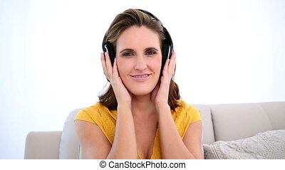 Smiling woman listening to music on