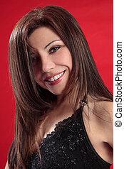 Smiling woman long lustrous hair