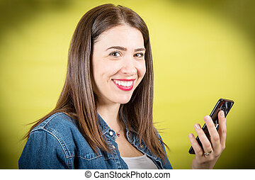 smiling woman look at the mobile phone