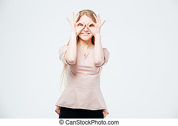 Smiling woman looking at camera through fingers