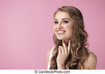 Smiling woman looking at copy space