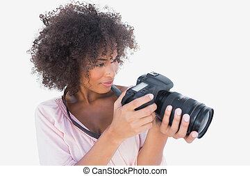 Smiling woman looking at digital camera