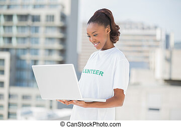 Smiling woman looking at her laptop