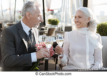 Smiling woman looking at her partner - Best day. Positive...