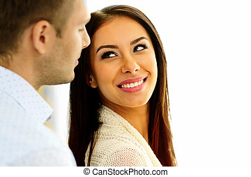 Smiling woman looking at man