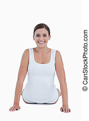 Smiling woman looking at the camera while doing exercises