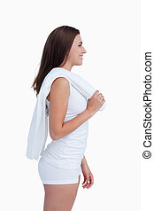 Smiling woman looking away while holding a towel