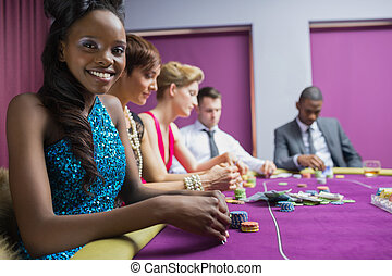 Smiling woman looking up from poker