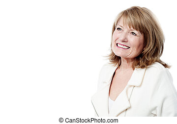 Smiling woman looking up