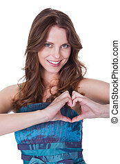 Smiling woman making a heart gesture