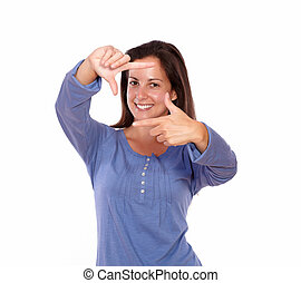 Smiling woman making frame with hands