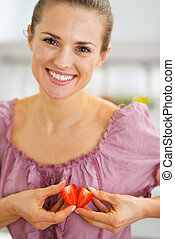 Smiling woman making heart