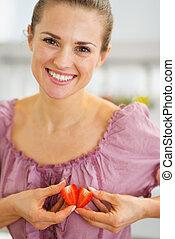 Smiling woman making heart