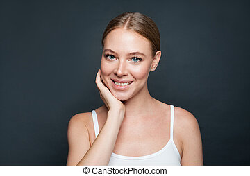 Smiling woman model on gray background