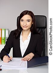 Smiling woman notary public notarizes the power of attorney...