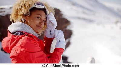 Smiling Woman on a Ski Slope - Happy young adult female...