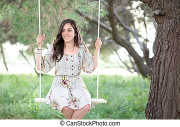 Smiling Woman on a Swing