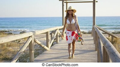 Smiling woman on a wooden beachfront promenade