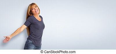 Smiling woman on blue background.