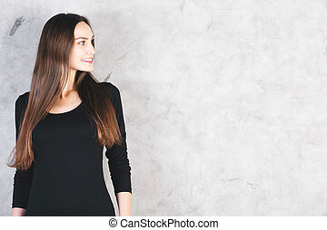 Smiling woman on concrete background