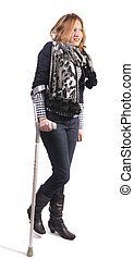 Smiling woman on crutches - Young smiling woman with hurt...