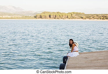 Smiling woman on pier