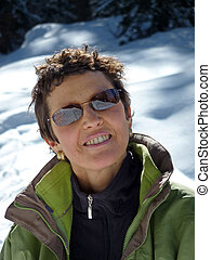 smiling woman on the alps in winter
