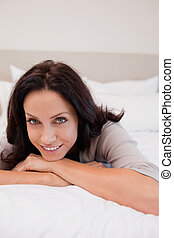 Smiling woman on the bed