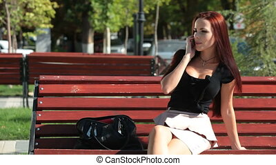 Smiling Woman On The Phone Outdoors