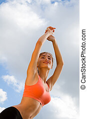 smiling woman on the sky background