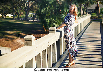 Smiling woman on the wooden bridge