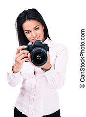 Smiling woman photographer with camera