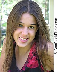 Smiling Woman - A pretty young woman with a beautiful smile.