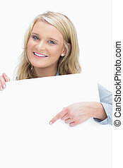 Smiling woman pointing on the paper