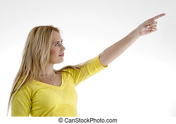 smiling woman pointing side