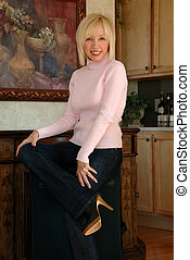 Smiling Woman Portrait - a blonde smiling woman in her 50s.