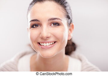 Smiling woman posing on white background - Cheerful young ...