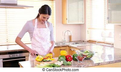 Smiling woman preparing a meal