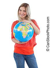 Smiling woman presenting a globe
