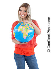 Smiling woman presenting a globe