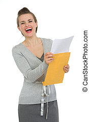 Smiling woman reading letter