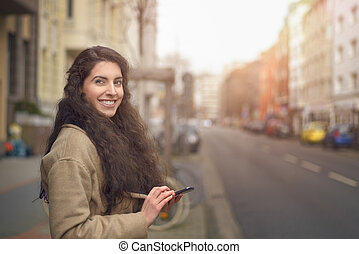 Smiling woman reading message on her mobile