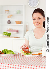 Smiling woman ready to eat a sandwich for lunch