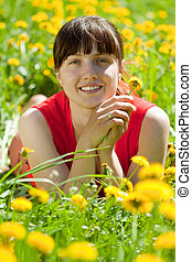 smiling  woman  relaxing  in grass