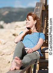 Smiling woman relaxing in the sun