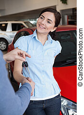 Smiling woman shaking the hand of a man
