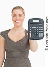 Smiling woman showing a calculator