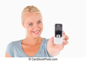 Smiling woman showing a mobile